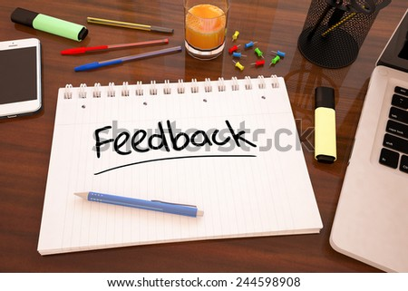 Feedback - handwritten text in a notebook on a desk - 3d render illustration. - stock photo