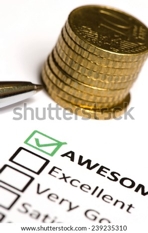 Feedback questionnaire and stack of coins and pen. - stock photo
