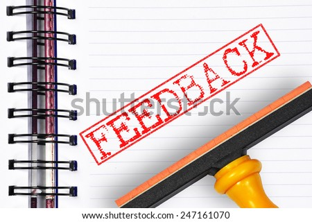 Feedback rubber stamp on the note book - stock photo