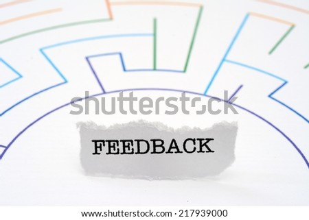 Feedback text on maze - stock photo