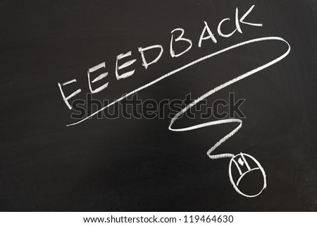 Feedback word and mouse symbol drawn on the blackboard - stock photo