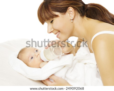Feeding baby. Newborn eating milk from bottle in Mother hand, Family over white background  - stock photo