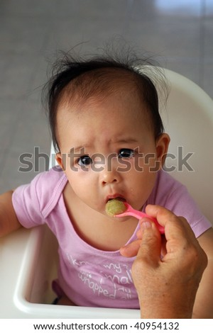 feeding baby with cereal