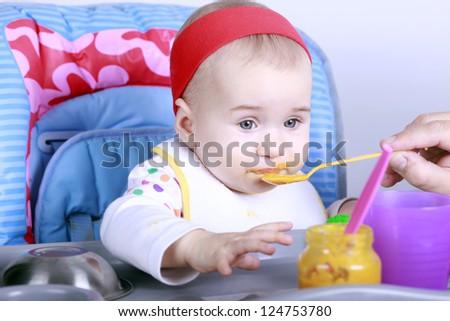 Feeding little baby - stock photo