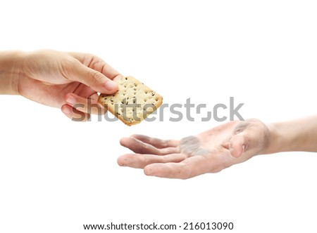 Feeding the poor concept with dirty hand receiving a cracker. - stock photo
