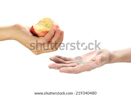 Feeding the poor concept with dirty hand receiving an apple. - stock photo
