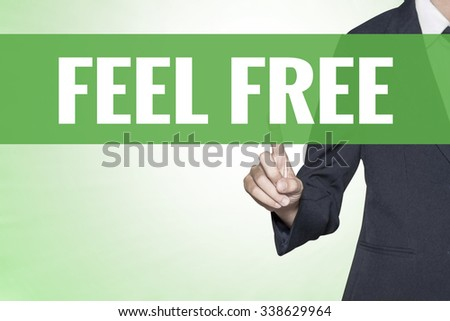 Feel Free word on green virtual screen touching by business woman - stock photo