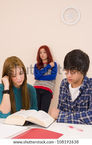 Feeling envy for her who gets to sit next to him - stock photo