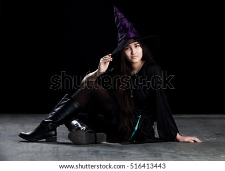 Feeling Witchy.  Attractive mixed race teen dressed as a witch.