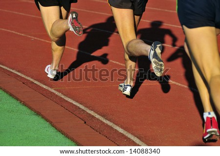 Feet  and shade of a running - stock photo