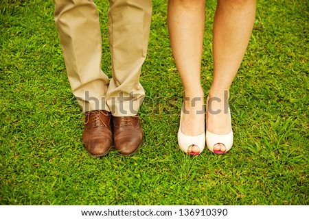 feet and shoes of newlyweds - stock photo