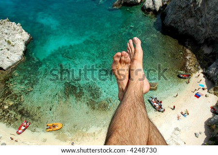feet and water at the tremiti islands - stock photo