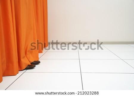 Feet Behind Curtain - stock photo