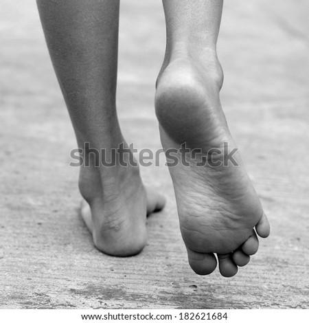 FEET , FOOT ,walk , black and white , B&W - stock photo