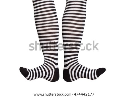 Feet in black-and-white striped socks isolated on white background