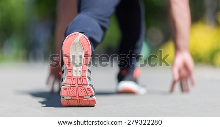 feet in running shoes  - stock photo