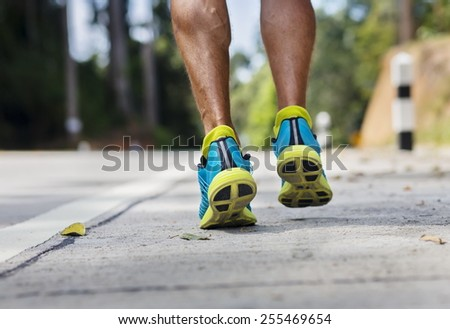 feet in running shoes closeup outdoors - stock photo