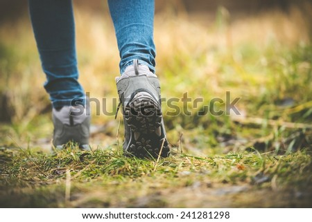 feet in shoes on a forest path - stock photo