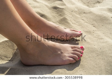 FEET IN THE SAND BEACH