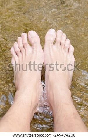 feet in waterfall , at phangnga thailand - stock photo