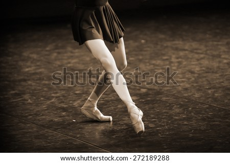 Feet of a classical dancer  during a ballet.Sepia effect added - stock photo