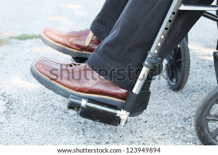 Feet of a person in a wheelchair