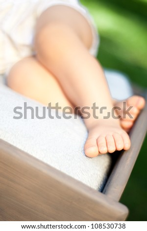 feet of a small baby on a blanket close-up