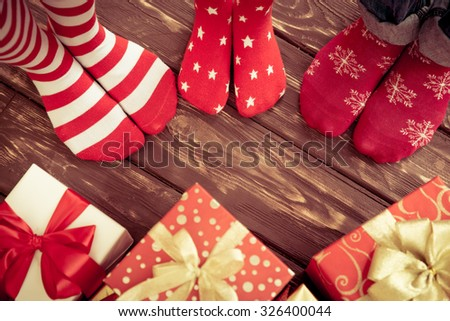 Feet of family on wood floor. Christmas holidays concept - stock photo