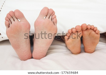 feet of father and son