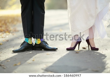 Feet of Groom and bride on wedding day.