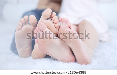 Feet of man and woman on a light background.