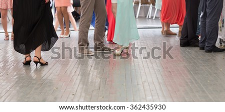 feet of people dancing on a  party. unrecognizable