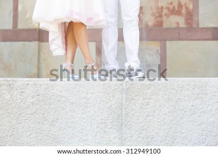 Feet of Wedding Couple - stock photo