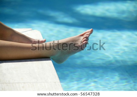 Feet of woman at a poolside