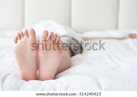 Feet of woman sleeping