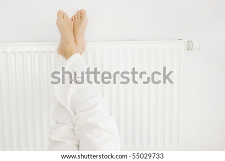 Feet on a white heater