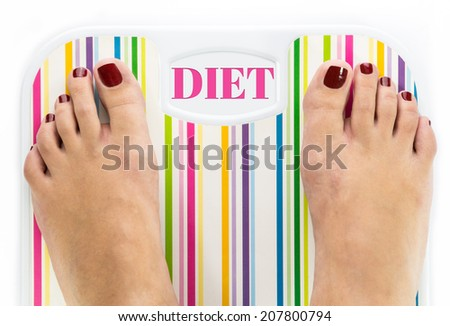 """Feet on bathroom scale with word """"Diet"""" on dial - stock photo"""
