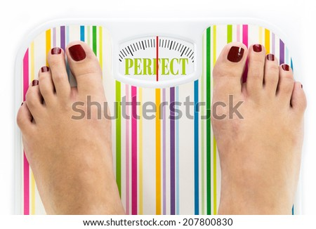 """Feet on bathroom scale with word """"Perfect"""" on dial - stock photo"""