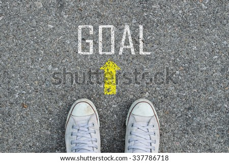 Feet on road with GOAL
