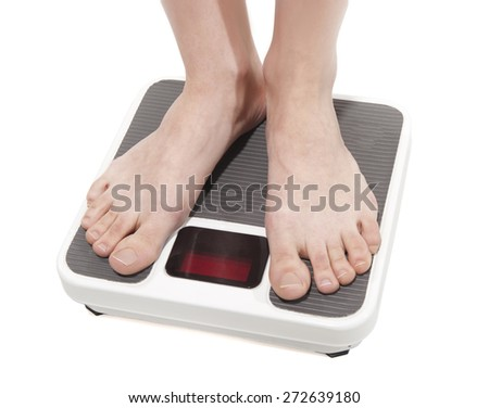 Feet on scales - stock photo