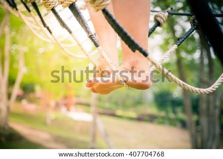 feet on slackline over water - stock photo