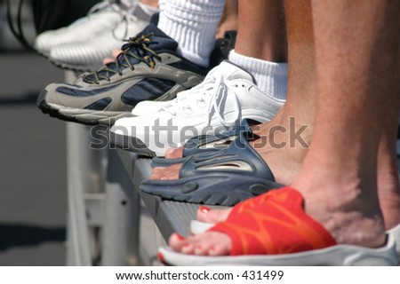 feet on the bleachers - stock photo