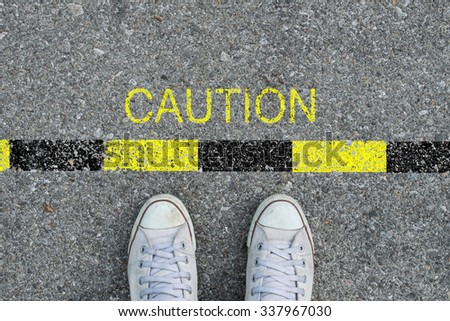 Feet on the street and say CAUTION