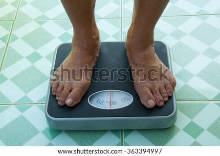 feet on the weight scale