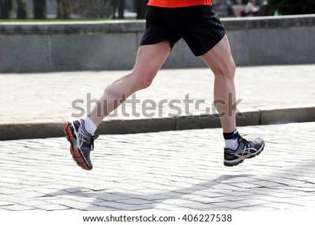 feet running athlete on a marathon distance - stock photo