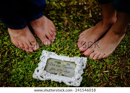 feet's close up of family couple together - stock photo