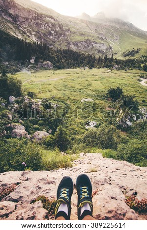 Feet Selfie Traveler relaxing on cliff mountains outdoor with aerial view on background Lifestyle hiking Travel concept summer vacations adventure - stock photo