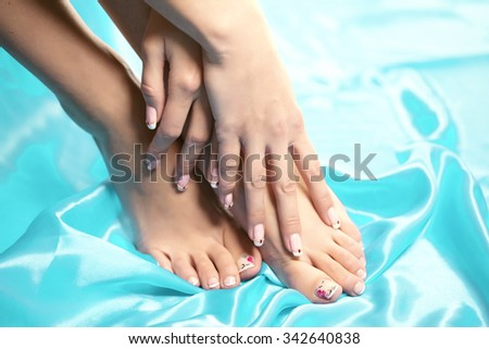 Feet spa, legs foot massage in spa. Woman feet care. Legs stockings, tights Image of beautiful manicured feet with a neat pedicure - stock photo