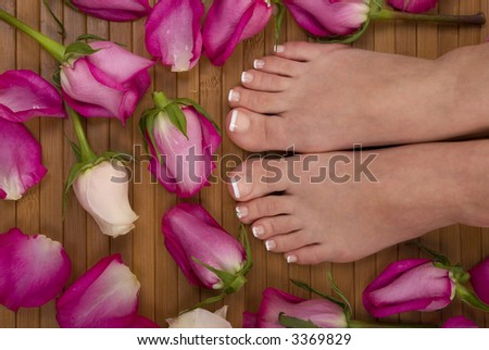 Feet with pink and white roses