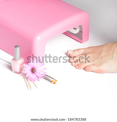 Feet with uv lamp for nails  - stock photo